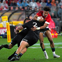 Aaron Smith and Codie Taylor tackle Anthony Watson during the 2017 DHL Lions Series 2nd test rugby match between the NZ All Blacks and British & Irish Lions at Westpac Stadium in Wellington, New Zealand on Saturday, 1 July 2017. Photo: Dave Lintott / lintottphoto.co.nz