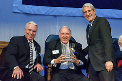 Yale President Peter Salovey and Athletics Director Thomas A. Beckett presenting Dick Baribault '49. Yale Athletics Blue Leadership Ball & George H.W. Bush '48 Lifetime of Leadership Awards. 20 November 2015 at the William K. Lanman Center, Payne Whitney Gymnasium, Yale University.