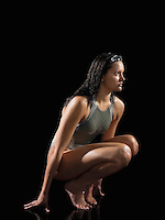 Female swimmer crouching side view