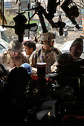 Major David Gehrich (left ? right) checks local purchase paperwork while Senior Master Sgt. Manuel Roblesreynoso, checks the sidewalk area, and Mr. Mohammad Essaq (center), interprets for them during a 4 April 2006 local purchase.  The material will support the U.S. Air Force and the Afghanistan National Army (ANA). The shops are converted containerized cargo containers set side by side. Major Gehrich, a native of Brooksville, Fl. Both are deployed to the 755th Expeditionary Mission Support Group, Detachment 2, Camp Eggers, Kabul, Afghanistan, and a member of an U.S. Air Force Embedded Training Team (EET). Gehrich is assigned to the Air Force Logistics Management Agency, Maxwell Air Force Base, Gunter Annex, Ala.  Senior Master Sgt. Roblesreynoso is a native of Los Angeles, CA, and assigned to the 15th Comptroller Sq, Hickam Air Force Base, Hi.  ETTs are fulfilling an U.S. Army request for forces in support of Office of Security Cooperation-Afghanistan (OSC-A) mission to advise, train and mentor Afghanistan National Army personnel on the U.S. Army logistics standard and methods.  The purchase of needed supplies and personal protection equipment will allow the ETT to continue mentoring the ANA, and for the ANA to operate safely and prepare for future missions. At the Central Workshop, reconditioning of small arms such as AK-47 rifles to field artillery repairs are performed. The funds for the purchases come from Field Ordering Officer funds that are used if items are not available from the Office of Security Cooperation-Afghanistan (OSC-A) or ANA supply systems in the time required -- purchases can not exceed $2,500.  The U.S. Air Force provides specialized personnel to fill U.S. Army request for forces.  This supports the OSC-A in its partnership with the Government of Afghanistan and the International Community to plan, program, and implement reform in Defense Sectors, develop a stable Afghanistan, and deter and defeat terrorism within its borders. (U.S. Air Force