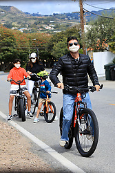 Simon Cowell and Lauren Silverman sport masks during a Sunday afternoon bike ride with their son and Lauren's other son in Malibu during COVID-19 virus pandemic lockdown in California. . 05 Apr 2020 Pictured: Simon Cowell, Lauren Silverman. Photo credit: Rachpoot/MEGA TheMegaAgency.com +1 888 505 6342