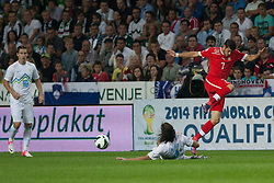 Marko Suler of Slovenia with sliding tackle against Tranquillo Barnetta of Switzerland during qualification football match for World Cup 2014 in Brazil between national team of Slovenia and Switzerland, on September 7, 2012 in Ljubljana, Slovenia. (Photo by Matic Klansek Velej / Sportida.com)