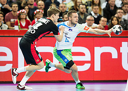 Rune Dahmke of Germany vs Gasper Marguc of Slovenia during handball match between National teams of Germany and Slovenia on Day 6 in Preliminary Round of Men's EHF EURO 2016, on January 20, 2016 in Centennial Hall, Wroclaw, Poland. Photo by Vid Ponikvar / Sportida