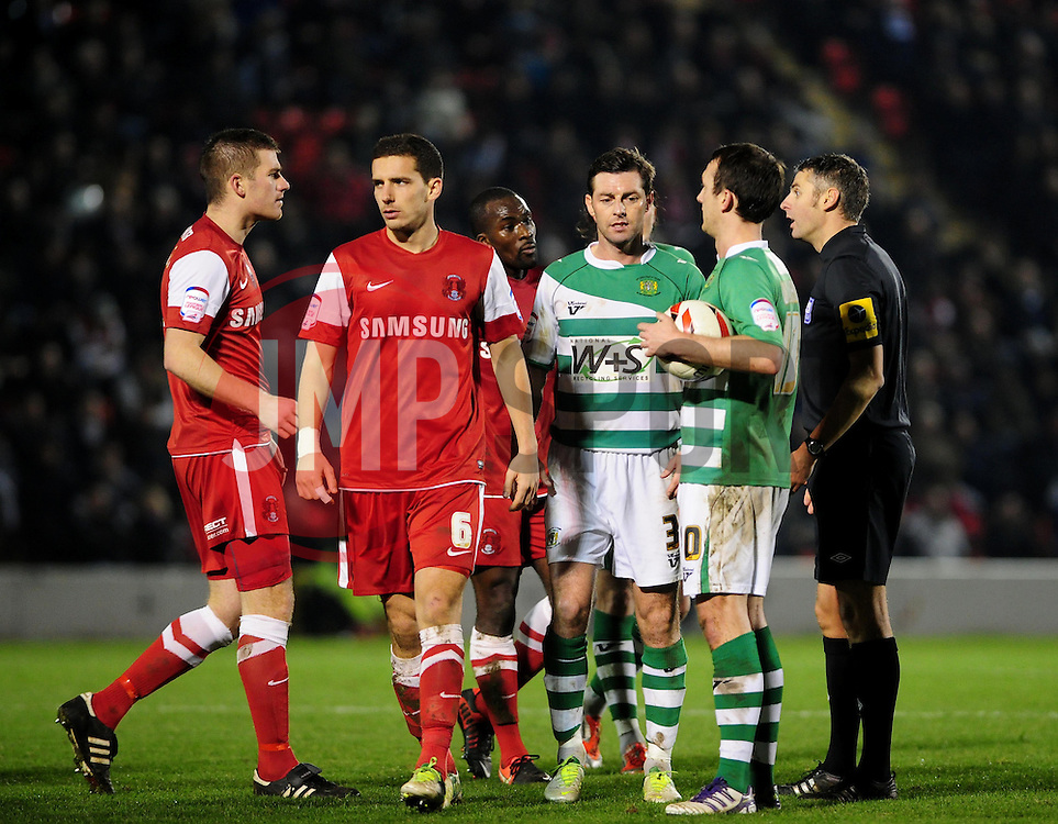 Players surround the referee after sending off Leyton Orient's Anthony Griffith - Photo mandatory by-line: Dougie Allward/JMP - Tel: Mobile: 07966 386802 09/01/2013 - SPORT - FOOTBALL - Matchroom Stadium - London -  Leyton Orient v Yeovil Town - Johnstone's Paint Trophy Southern area semi-final.