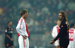 10-12-2002 VOETBAL: CHAMPIONS LEAGUE AJAX - AS ROMA: AMSTERDAM<br /> Batistuta en Bergdolmo<br /> ©2002-Ronald Hoogendoorn