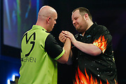 Michael van Gerwen celebrates and shakes Ryan Joyce's hand during the World Darts Championships 2018 at Alexandra Palace, London, United Kingdom on 29 December 2018.