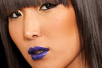 Close-up view of stylish Asian woman looking away