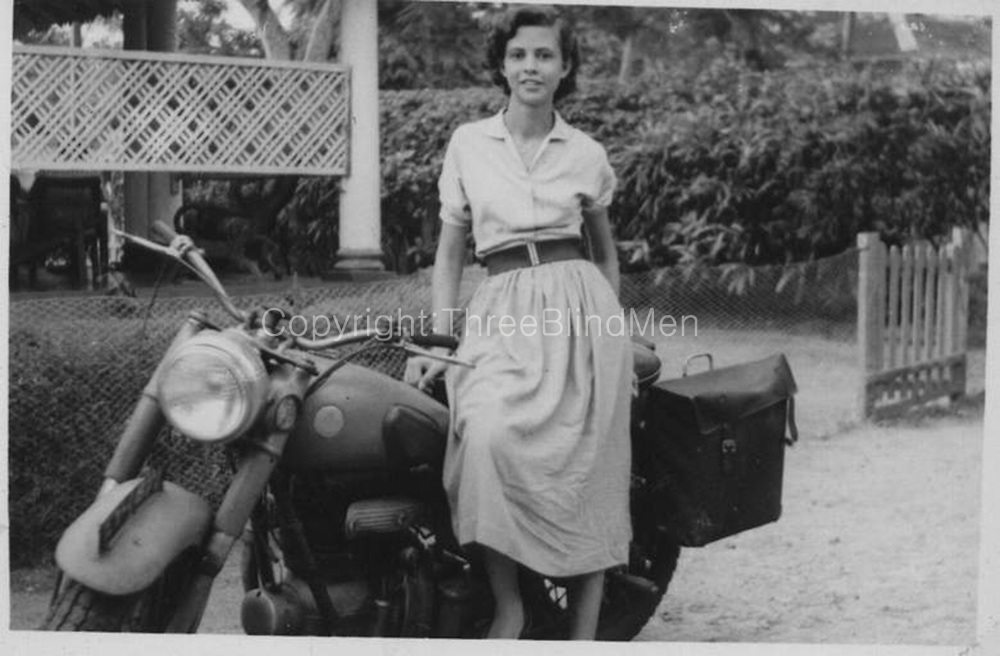 Rita White (who was to become Mark's wife) seated on a Sunbeam S7 motorbike.<br /> Layards Road, in Colombo 5. 1958