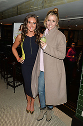 Left to right, NATASHA CORRETT and CAGGIE DUNLOP at a party to celebrate the publication of Honestly Healthy Cleanse by Natasha Corrett held at Tredwell's Restaurant, 4a Upper St.Martin's Lane, London on 14th January 2015.