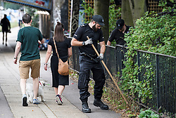 © Licensed to London News Pictures. 25/08/2018. London, UK. Police officers perform searches around Notting Hill, West London ahead of the 2018 Notting Hill Carnival which starts tomorrow (Sunday). Up to 1 million people are expected to attend this weekend's event that is one of the worlds largest street festivals. Photo credit: Ben Cawthra/LNP