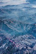 Through the smoke, the bright lines of fire retardant coat the ridges of the mountains below. ©2016 Sivani Babu