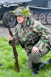 A Re-enactor portrayiing a German infantryman during a battle battle re-enactment in on Pickering Showground<br /> <br /> 17/18 October 2015<br />  Image © Paul David Drabble <br />  www.pauldaviddrabble.co.uk