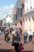 Shoppers walking in a pedestrianised shopping area in the town centre of Ipswich, Suffolk, England, UK