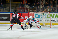 KELOWNA, CANADA - JANUARY 4: James Porter #1 of the Kelowna Rockets defends the net during the shoot out as Tyson Upper #9 of the Prince George Cougars prepares to take a shot on January 4, 2019 at Prospera Place in Kelowna, British Columbia, Canada.  (Photo by Marissa Baecker/Shoot the Breeze)