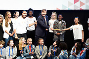 Koning Willem-Alexander tijdens het begin van de Week voor de Gezonde Jeugd in de Werkspoorkathedraal in Utrecht. Gedurende de week vinden op scholen, verenigingen en in buurthuizen activiteiten plaats die een gezonde leefstijl stimuleren.<br /> <br /> King Willem-Alexander during the beginning of the Week for Healthy Youth in the Werkspoorkathedraal in Utrecht. During the week activities take place at schools, associations and in community centers that stimulate a healthy lifestyle. <br /> <br /> <br /> Op de foto / On the photo:  Openingshandeling Week voor de Gezonde Jeugd door <br /> Z.M. Koning Willem-Alexander, JOGG-ambassadeur Juvat Westendorp en kinderen van de Juvat Dance Academy