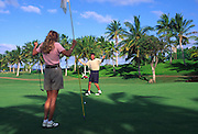 Couple golfing, Hawaii<br />