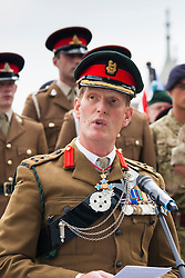 London, June 23rd 2014. Deputy Commander Brigadier Richard Smith addresses members and veterans of the armed forces and other dignitaries as they gather at City Hall for a flag raising ceremony to mark Armed Forces Day.