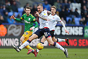Bolton Wanderers defender David Wheater (31) and Preston North End forward Tom Barkhuizen (29) during the EFL Sky Bet Championship match between Bolton Wanderers and Preston North End at the University of  Bolton Stadium, Bolton, England on 9 February 2019.