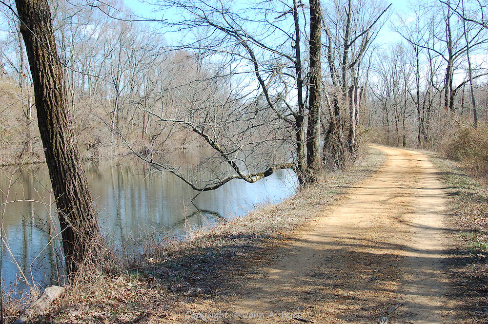 A beautiful clear spring day The blue sky reflecting on the canal give a hint of the beauty to come. Along the tow path of the D and R canal in Hillsborough, NJ