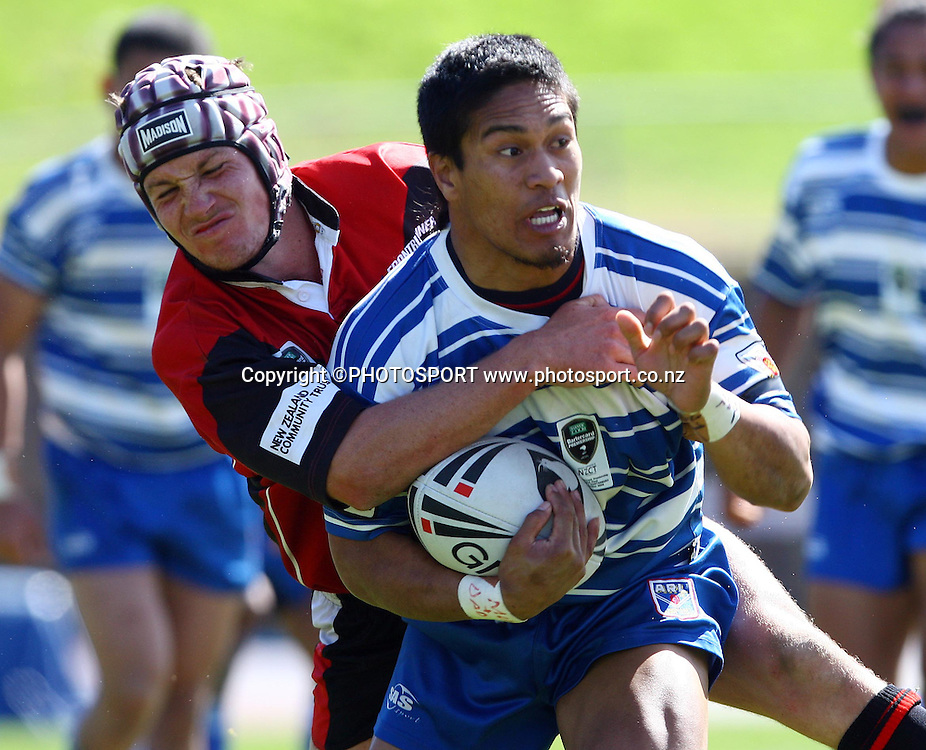 Tui Samoa of Auckland is tackled by Bulls wing Scott Hurrell.<br />
