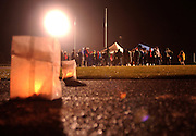 Friends, family and well wishers gather in the rain at a candlelight vigil held for  former Central Lake, Michigan high school track star Ryan Shay.  Shay died November 3rd while running a marathon in New York.
