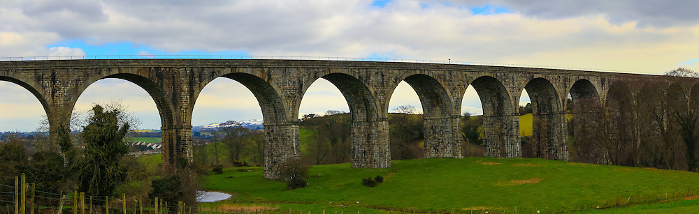 Craigmore viaduct near Newry, with the snow-topped Mournes just visible in the far background.