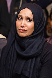 © Licensed to London News Pictures. 01/05/2015. London, UK. Councillor, Rabina Khan listens to ex Mayor of Tower Hamlets, Lutfur Rahman endorce her as his proposed candidate at a public meeting held at the Waterlily in Stepney, east London on 30th April 2015. The meeting was ex Mayor of Tower Hamlets, Lutfur Rahman's first public appearance after being found guilty of electoral fraud last week and called for attendees to donate money to a legal fund to facilitate an appeal against the High Court ruling. Photo credit : Vickie Flores/LNP
