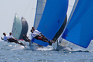 Andy and Tom Partington battle with Ian Pinnell and Ian Mitchell during the 2008 POW Race at Weymouth