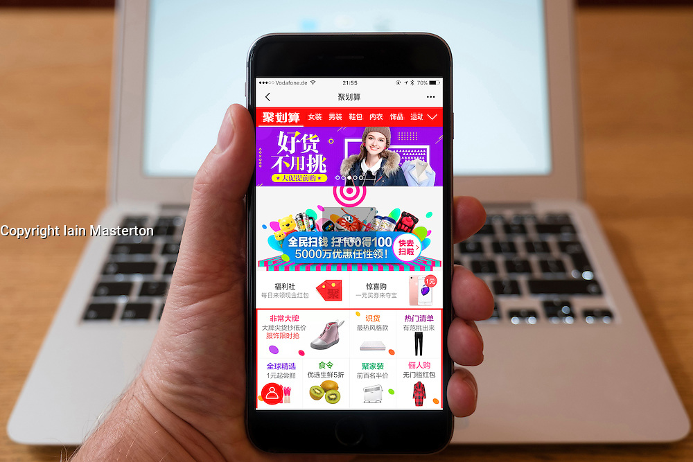 Using iPhone smartphone to display homepage of Taobao website  the popular e-commerce website in China