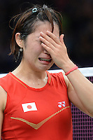 Sato Sayaka of Japan unable to cary on with injury when playing Tine Baun, Denmark, Olympic Badminton London Wembley 2012