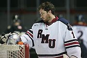 Robert Morris goaltender Terry Shafer removes his helmet during the Atlantic Hockey Semifinal against Army in Rochester on Friday, March 18, 2016.