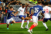 Aaron Wan-Bissaka England U21s (Crystal Palace) kept on his toes by Greg Taylor Scotland U21s (Kilmarnock FC) during the U21 UEFA EUROPEAN CHAMPIONSHIPS match Scotland vs England at Tynecastle Stadium, Edinburgh, Scotland, Tuesday 16 October 2018.
