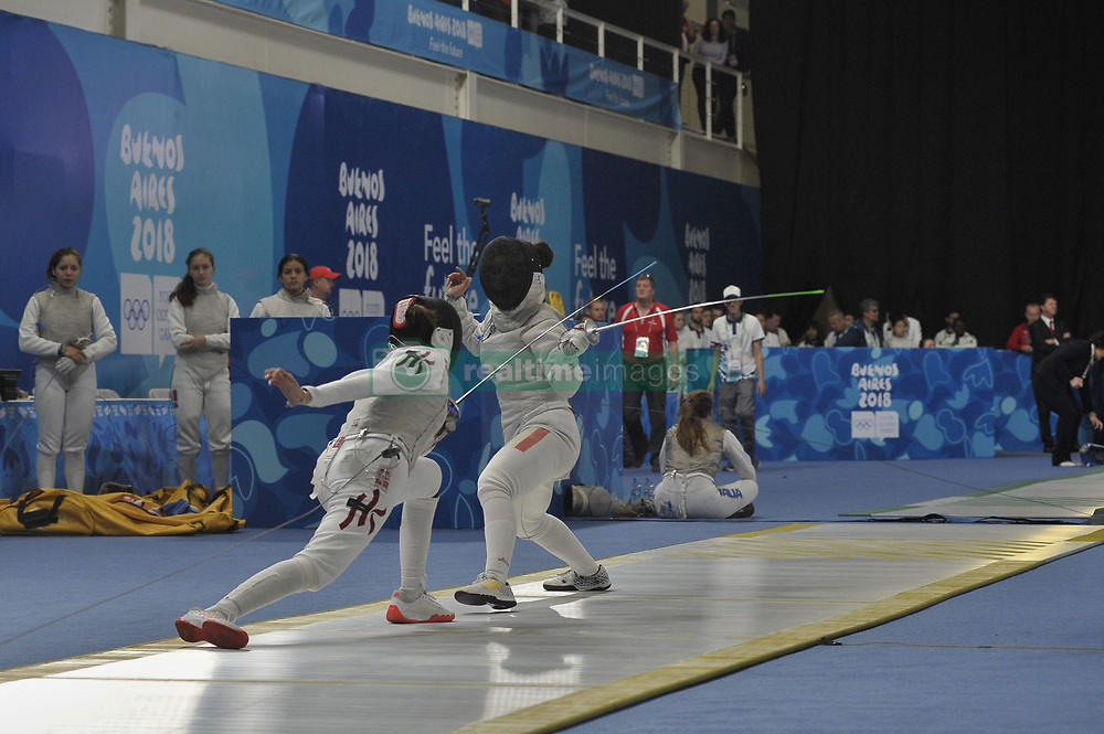 October 7, 2018 - Buenos Aires, Buenos Aires, Argentina - CHRISTELLE JOY KO of Hong Kong and REBECA CANDESCU of Romania compete during the Women's Individual Foil on Day 1 of the Buenos Aires 2018 Youth Olympic Games at the Olympic Park. (Credit Image: © Julieta Ferrario/ZUMA Wire)