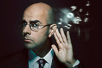 Bald businessman listening to music