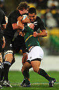 Ricky Januarie tries to tackle Mils Muliaina as Adam Thomson moves in to help.<br /> Philips Tri Nations, All Blacks vs South Africa at Westpac Stadium, Wellington, New Zealand, Saturday 5 July 2008. Photo: Dave Lintott/PHOTOSPORT