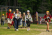 The Future In Sight group (formerly NH Association for the blind) walks over to the Panorama lift at Gunstock Mountain following their introductory zip at base camp on Thursday afternoon.  (Karen Bobotas/for the Laconia Daily Sun)