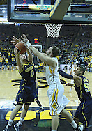 January 14, 2011: Michigan Wolverines guard Zack Novak (0) and Iowa Hawkeyes forward Andrew Brommer (20) battle for a rebound during the NCAA basketball game between the Michigan Wolverines and the Iowa Hawkeyes at Carver-Hawkeye Arena in Iowa City, Iowa on Saturday, January 14, 2011. Iowa defeated Michigan 75-59.