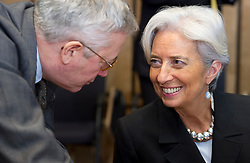 Christine Lagarde, France's finance minister, right, speaks with Giulio Tremonti, Italy's finance minister, during an emergency meeting of euro zone finance ministers in Brussels, on Sunday, May 2, 2010. Greece accepted an unprecedented bailout from the European Union and International Monetary Fund worth more than 110 billion euros ($146 billion). (Photo © Jock Fistick)