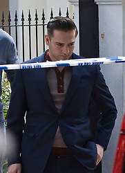 © licensed to London News Pictures.  ile picture dated 28/07/2011. London, UK. Reg Traviss, former boyfriend of Amy Winhouse leaving Amy's home in Camden, North London on 28/07/2011, following her death. Reg Traviss has been charged with two counts of rape. Ben Cawthra/LNP