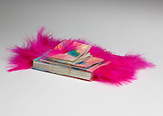 Three different sizes of book sewn into one book but hot pink boa feathers.