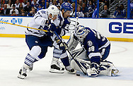 Tampa Bay Lightning goalie Anders Lindback (R) makes a save as teammate Martin St. Louis defends against Toronto Maple Leafs' Leo Komarov during the first period of their NHL hockey game in Tampa, Florida February 19, 2013.  REUTERS/Mike Carlson (UNITED STATES)