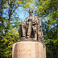 "Abraham Lincoln ""The Head of State"" statue in Chicago. The bronze statue is located in Chicago's Lincoln Park and is also known as Seated Lincoln or Sitting Lincoln. Photo is vertical, high resolution and was taken in May 2010."
