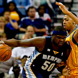 Mar 22, 2013; New Orleans, LA, USA; Memphis Grizzlies power forward Zach Randolph (50) drives against New Orleans Hornets power forward Anthony Davis (23) during the first quarter of a game at the New Orleans Arena.  Mandatory Credit: Derick E. Hingle-USA TODAY Sports
