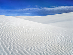 Late afternoon looking across softly undulating dunes of white gypsum at White Sands National Monument, NM