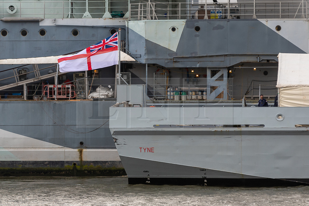 © Licensed to London News Pictures. 04/02/2020. London, UK. HMS Tyne seen moored in front of Tower Bridge next to HMS Belfast on the River Thames during a London visit. HMS Tyne is one of the three River-class patrol ships built to safeguard the fishing stocks and enforce national and EU fisheries legislation within British Fishery Limits, including protecting and patrolling in the Strait of Gibraltar. Along with HMS Severn and HMS Mersey, the fleet of three make up the Fishery Protection Squadron – the 'Cod Squad' – the oldest unit in the Royal Navy. Photo credit: Vickie Flores/LNP