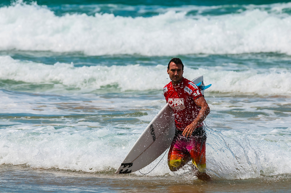 Pro surfer competing in the Australian Open of Surfing, Manly Beach, Sydney, New South Wales, Australia