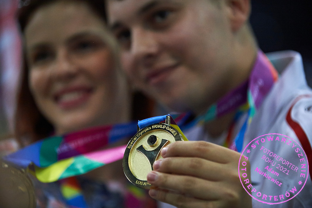 Patryk Jaszcz poses with gold medals after medal ceremony after bowling competition during fifth day of the Special Olympics World Games Los Angeles 2015 on July 29, 2015 at Los Angeles Convention Centre in Los Angeles, USA.<br /> <br /> USA, Los Angeles, July 29, 2015<br /> <br /> Picture also available in RAW (NEF) or TIFF format on special request.<br /> <br /> For editorial use only. Any commercial or promotional use requires permission.<br /> <br /> Adam Nurkiewicz declares that he has no rights to the image of people at the photographs of his authorship.<br /> <br /> Mandatory credit:<br /> Photo by &copy; Adam Nurkiewicz / Mediasport