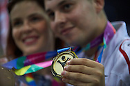 Patryk Jaszcz poses with gold medals after medal ceremony after bowling competition during fifth day of the Special Olympics World Games Los Angeles 2015 on July 29, 2015 at Los Angeles Convention Centre in Los Angeles, USA.<br /> <br /> USA, Los Angeles, July 29, 2015<br /> <br /> Picture also available in RAW (NEF) or TIFF format on special request.<br /> <br /> For editorial use only. Any commercial or promotional use requires permission.<br /> <br /> Adam Nurkiewicz declares that he has no rights to the image of people at the photographs of his authorship.<br /> <br /> Mandatory credit:<br /> Photo by © Adam Nurkiewicz / Mediasport