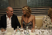 Elle MacPherson and Nicholas Coleridge. Natalia Vodianova and Elle Macpherson host a dinner in honor of Francisco Costa (creative Director for women) and Italo Zucchelli (creative director for men)  of Calvin Klein. Locanda Locatelli, 8 Seymour St. London W1. ONE TIME USE ONLY - DO NOT ARCHIVE  © Copyright Photograph by Dafydd Jones 66 Stockwell Park Rd. London SW9 0DA Tel 020 7733 0108 www.dafjones.com