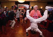 Xavier Mascareñas/Treasure Coast Newspapers; Connie Kurtz (right), of West Palm Beach, reacts as Whitfield Morley, a professional entertainer who said he's a Murphy family friend from Nassau, Bahamas, celebrates with her at the election night party for U.S. Congressional District 18 incumbent Democrat Rep. Patrick Murphy, after Republican opponent Carl Domino conceded the race, at the DoubleTree in Palm Beach Gardens on Nov. 4, 2014.